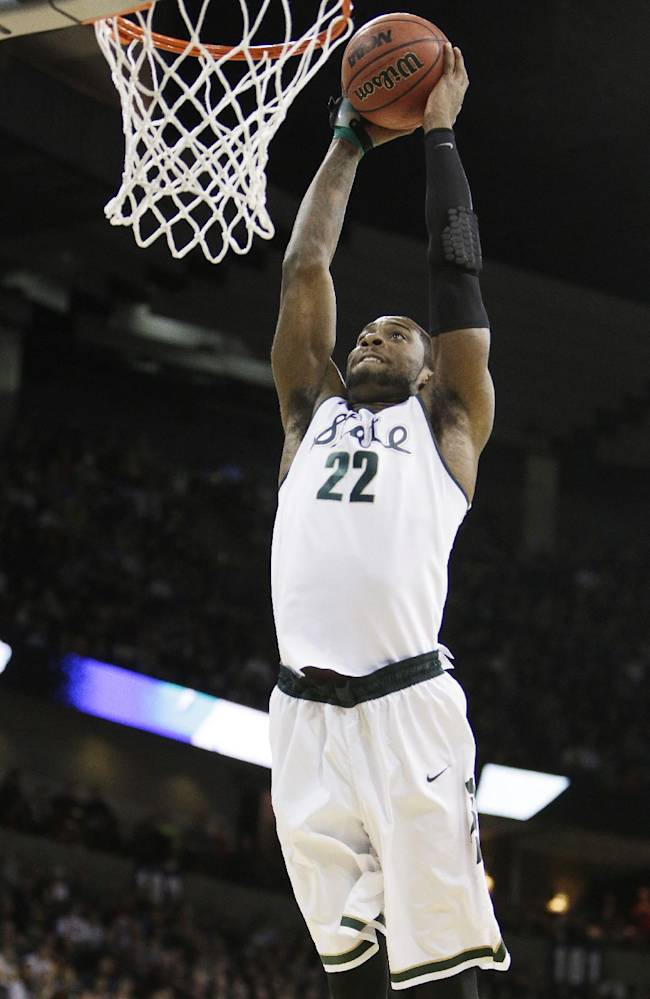 Michigan State's Branden Dawson (22) dunks in the first half during the third-round game of the NCAA men's college basketball tournament against Harvard in Spokane, Wash., Saturday, March 22, 2014