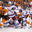 New York Rangers' Henrik Lundqvist, bottom center, of Sweden, covers up the puck as Anton Stralman, center left, of Sweden, deals with Philadelphia Flyers' Scott Hartnell, left, and Rangers' Ryan McDonagh, right center, defends Flyers' Wayne Simmonds cent