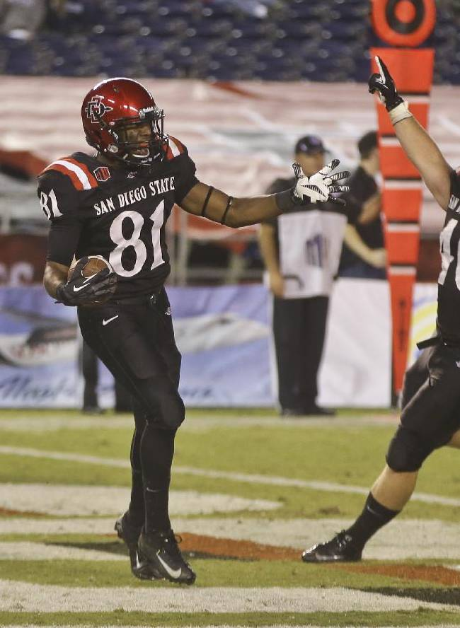 San Diego State wide receiver Eric Judge, left,  and Chad Young celebrate after Judge's thirteen yard touchdown reception in overtime against Nevada that proved to be the winning score in San Diego State's 51-44 victory in a NCAA college football game  Friday, Oct. 4, 2013, in San Diego