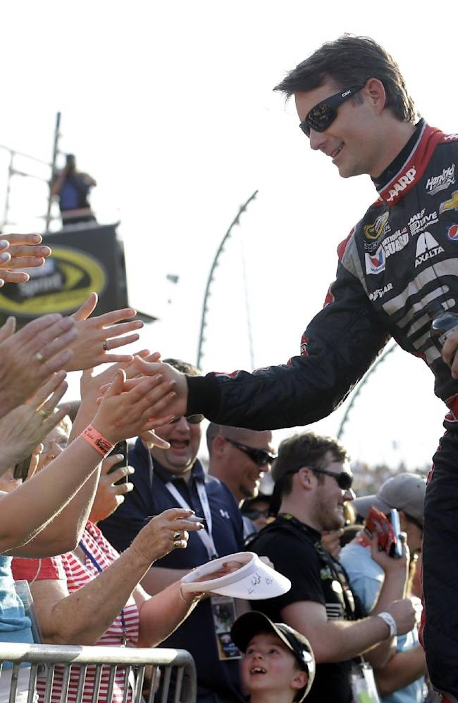 Jeff Gordon greets fans during driver introductions for the NASCAR Sprint Cup auto race at Richmond International Raceway in Richmond, Va., Saturday, April 26, 2014