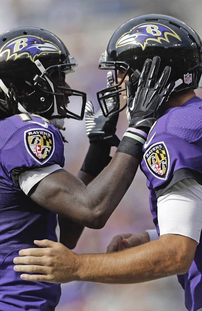 Baltimore Ravens wide receiver Marlon Brown, left, celebrates his touchdown with quarterback Joe Flacco, right, during the second half of an NFL football game against the Cleveland Browns in Baltimore, Md., Sunday, Sept. 15, 2013