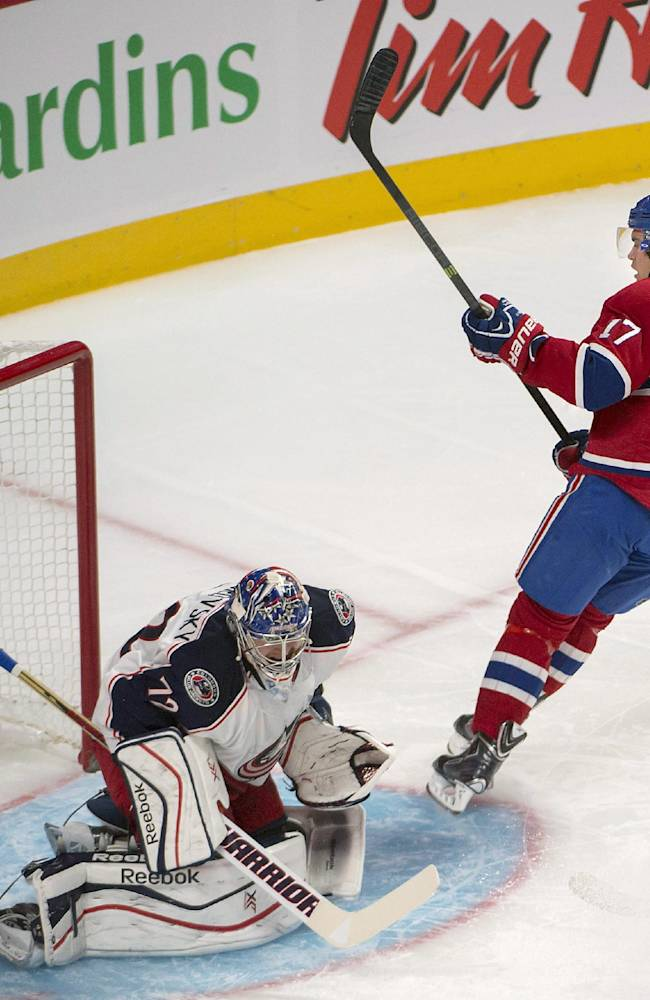 Montreal Canadiens' Rene Bourque, (17), scores during the first period of an NHL hockey game, Thursday, Oct. 17, 2013 in Montreal