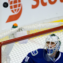 Vancouver Canucks goalie Eddie Lack, of Sweden, watches the puck after making a save against the Calgary Flames during second period NHL hockey action in Vancouver, British Columbia, on Saturday March 8, 2014 The Associated Press