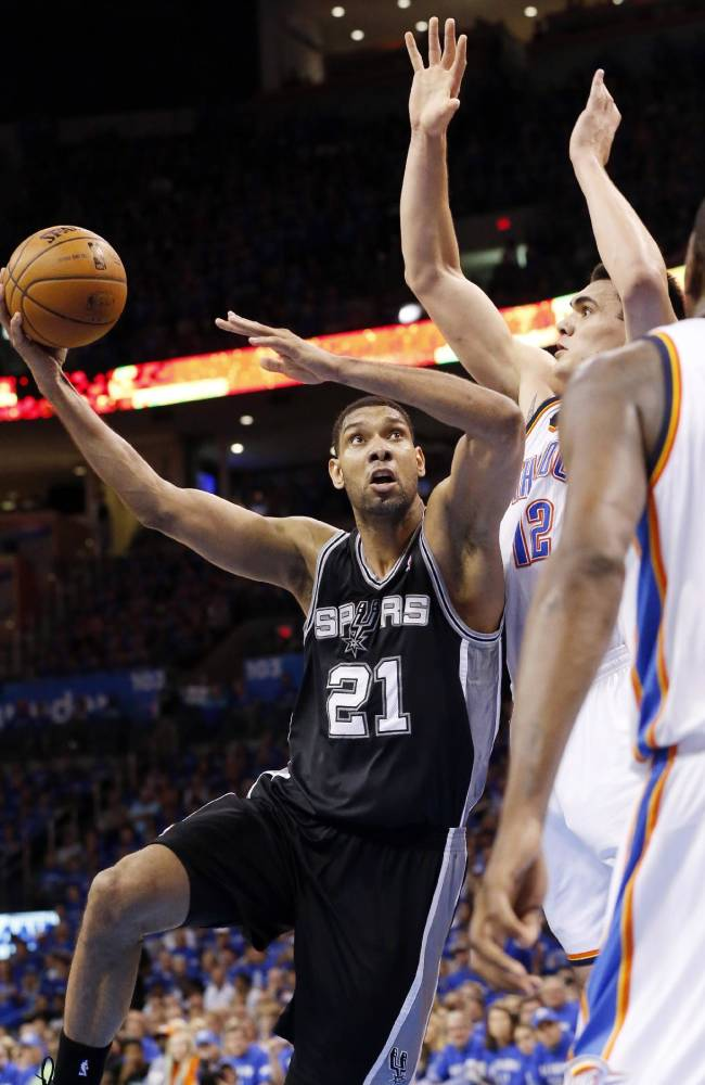 San Antonio Spurs forward Tim Duncan (21) shoots in front of Oklahoma City Thunder center Steven Adams (12) in the fourth quarter of Game 3 of an NBA basketball playoff series in the Western Conference finals, Sunday, May 25, 2014, in Oklahoma City. Oklahoma City won 106-97