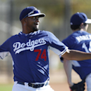 Los Angeles Dodgers pitcher Kenley Jansen throws during spring training baseball practice Tuesday, Feb. 11, 2014, in Glendale, Ariz The Associated Press