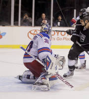 Los Angeles Kings left wing Kyle Clifford (13) watches as the puck, shot by center Trevor Lewis (22) gets by New York Rangers goalie Henrik Lundqvist (30) for a goal in the second period of a preseason NHL hockey game, Friday, Sept. 27, 2013 in Las Vegas. (AP Photo/Julie Jacobson)