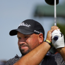 Brendon de Jonge, of Zimbabwe, watches his tee shot off the ninth hole during the second round of the McGladrey Classic golf tournament on Friday, Oct. 24, 2014, in St. Simons Island, Ga. (AP Photo/Stephen B. Morton)