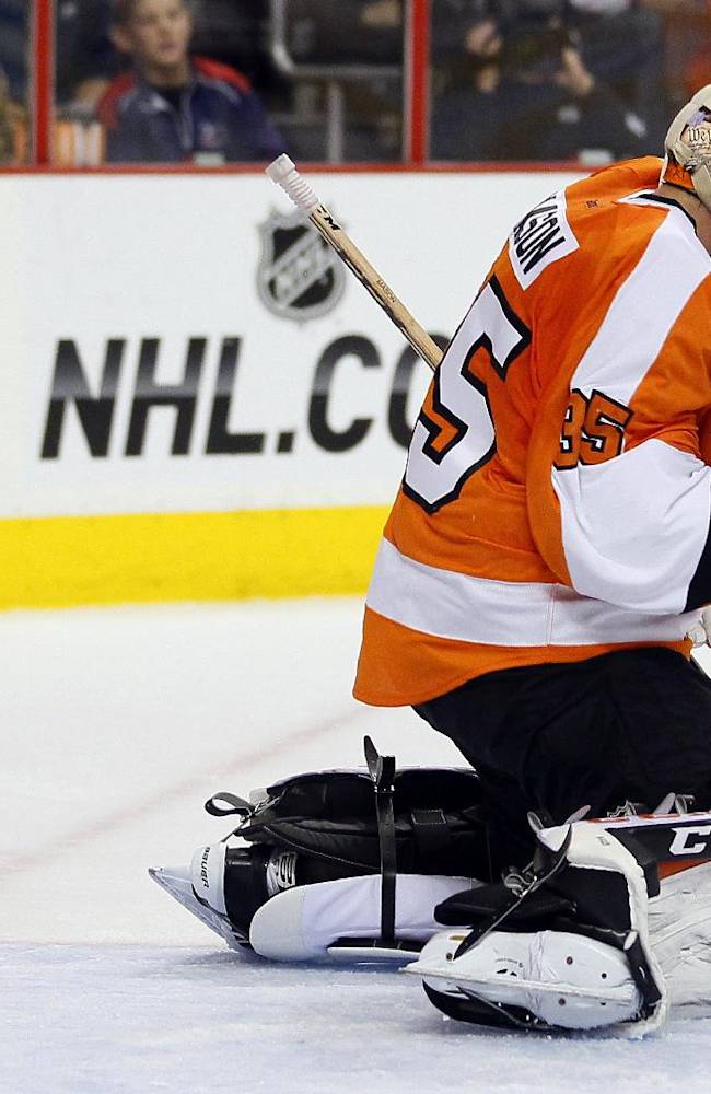 The puck flies past Philadelphia Flyers goalie Steve Mason and into the net for a goal by Washington Capitals' Nicklas Backstrom in the first period of an NHL hockey game, Friday, Nov.1, 2013, in Philadelphia