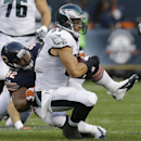 Chicago Bears defensive tackle Stephen Paea (92) tackles Philadelphia Eagles tight end Brent Celek (87) in the first half of an NFL preseason football game Friday, Aug. 8, 2014, in Chicago The Associated Press