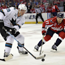 San Jose Sharks center Logan Couture (39) skates with the puck against Washington Capitals defenseman Karl Alzner (27) during the first period of an NHL hockey game, Tuesday, Oct. 14, 2014, in Washington The Associated Press