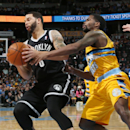 Brooklyn Nets guard Deron Williams, left, picks up loose ball as Denver Nuggets guard Aaron Brooks defends during the first quarter of an NBA basketball game in Denver on Thursday, Feb. 27, 2014 The Associated Press