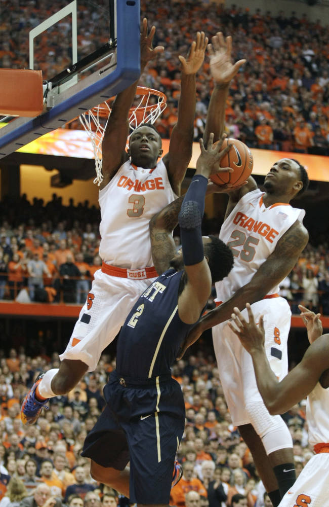 Syracuse's Jerami Grant (3) and Rakeem Christmas (26) put pressure on Pittsburgh's Michael Young in the first half of an NCAA college basketball game in Syracuse, N.Y., Saturday, Jan. 18, 2014