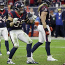 Houston Texans defensive end J.J. Watt (99) dances during a break between plays against the Jacksonville Jaguars during the second half of an NFL football game Sunday, Dec. 28, 2014, in Houston. (AP Photo/David J. Phillip)