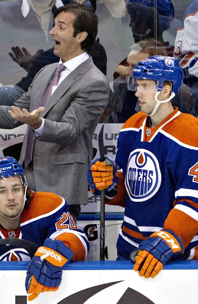 Edmonton Oilers head coach Dallas Eakins reacts to a call as players Jesse Joensuu (6), Luke Gazdic (20), Will Acton (41) and Boyd Gordon (27) look on while playing against the San Jose Sharks during third period NHL hockey action in Edmonton, Alberta Friday Nov. 15, 2013