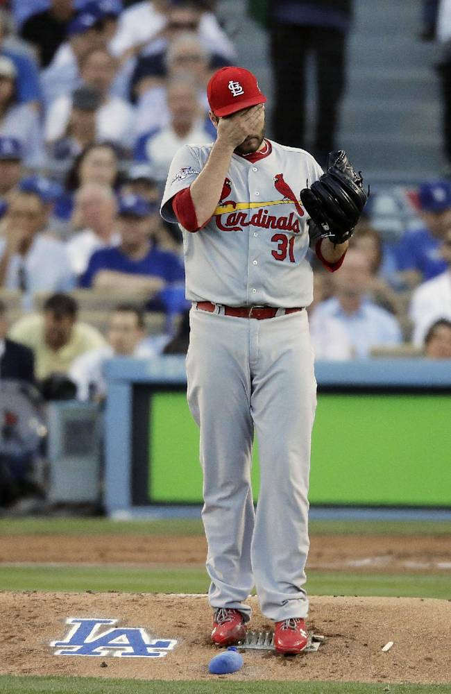 St. Louis Cardinals starting pitcher Lance Lynn reacts after walking Los Angeles Dodgers' Yasiel Puig during the second inning of Game 4 of the National League baseball championship series Tuesday, Oct. 15, 2013, in Los Angeles