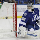 Tampa Bay Lightning goalie Ben Bishop (30) makes a stick save on a shot by the Florida Panthers during the first period of an NHL preseason hockey game Saturday, Oct. 4, 2014, in Tampa, Fla The Associated Press