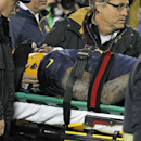Green Bay Packers tight end Jermichael Finley is taken off the field after being injured on a play against the Cleveland Browns during an NFL football game Sunday, Oct. 20, 2013, in Green Bay, Wis The Associated Press