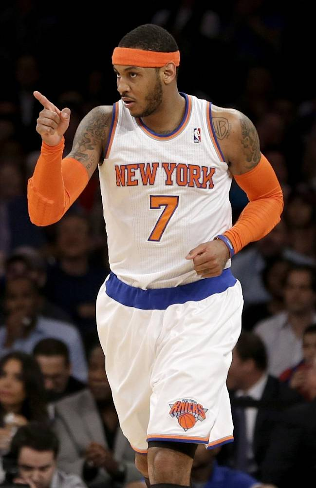 New York Knicks' Carmelo Anthony points after sinking a basket during the first half against the Indiana Pacers in an NBA basketball game at Madison Square Garden, Wednesday, March 19, 2014, in New York