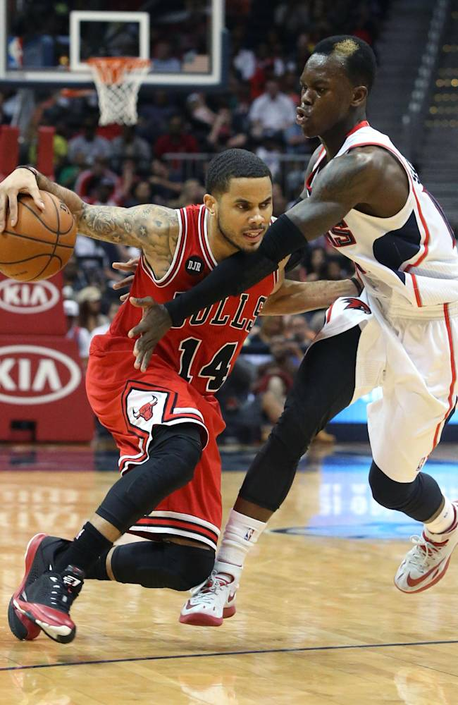 Chicago Bulls guard D.J. Augustin (14) drives against Atlanta Hawks guard Dennis Schroder (17) in the second half of an NBA basketball game Wednesday, April 2, 2014, in Atlanta. The Bulls won 105-92