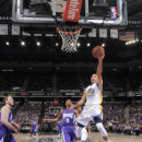 SACRAMENTO, CA - OCTOBER 29: Stephen Curry #30 of the Golden State Warriors shoots a layup against the Sacramento Kings on October 29, 2014 at Sleep Train Arena in Sacramento, California. (Photo by Rocky Widner/NBAE via Getty Images)