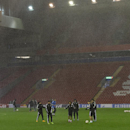 Real Madrid players react as heavy rain falls as they train at Anfield Stadium, in Liverpool, England, Tuesday, Oct. 21, 2014. Real Madrid will play Liverpool in a Champion's League Group B soccer match on Wednesday