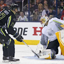Team Foligno's Radim Vrbata (17) of the Vancouver Canucks gets a goal past Team Toews' goalie Roberto Luongo of the Florida Panthers during the first period of the NHL All-Star hockey game in Columbus, Ohio, Sunday, Jan. 25, 2015 The Associated Press