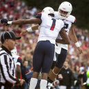 Arizona wide receiver Cayleb Jones (1) and quarterback Anu Solomon (12) celebrate after connecting for a touchdown against Washington State during the second quarter of an NCAA college football game Saturday, Oct. 25, 2014, in Pullman, Wash. (AP Photo/Dean Hare)