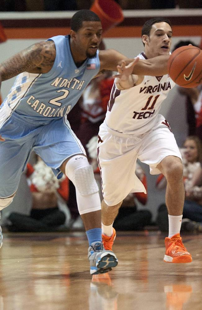 North Carolina's Leslie McDonald (2) goes for a loose ball against Virginia Tech's Devin Wilson (11) during the first half of an NCAA college basketball game, Saturday, March 1, 2014, in Blacksburg, Va