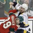 Nashville Predators center Mike Fisher (12) and Minnesota Wild defenseman Nate Prosser (39) fight during the third period of an NHL hockey game in St. Paul, Minn., Saturday, Jan. 10, 2015. The Predators won 3-1 The Associated Press