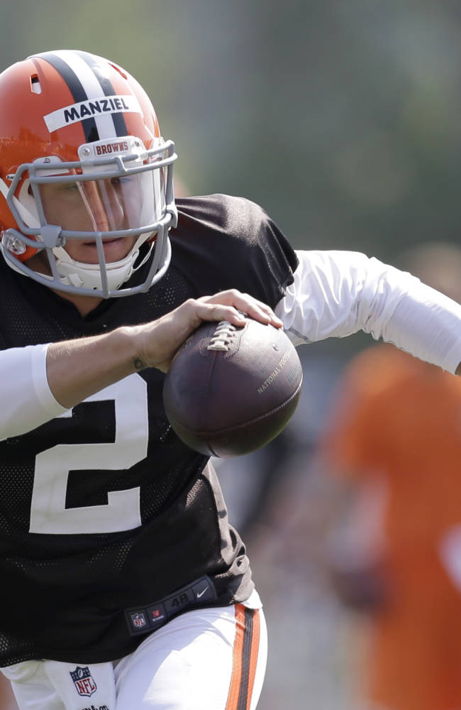 Cleveland Browns quarterback Johnny Manziel runs during practice at the NFL football team's training camp Monday, Aug. 4, 2014, in Berea, Ohio. Manziel has taken his first snaps in training camp with Cleveland's starters. Manziel is trying to beat out Brian Hoyer for the starting job. The former Heisman Trophy winner from Texas A&M had worked exclusively with Cleveland's second-string offense until Monday. (AP Photo/Tony Dejak)