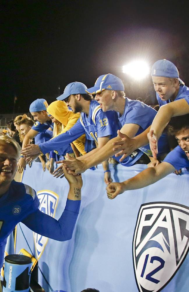 UCLA quarterback Jerry Neuheisel celebrates after their win against New Mexico State during an NCAA college football game Saturday, Sept. 21, 2013, in Pasadena, Calif. UCLA won 59-13