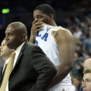 UCLA's Joshua Smith, center, and David Wear react from the bench during the second half of an NCAA college basketball game against Cal Poly in Los Angeles, Sunday, Nov. 25, 2012. Cal Poly won 70-68. (AP Photo/Jason Redmond)