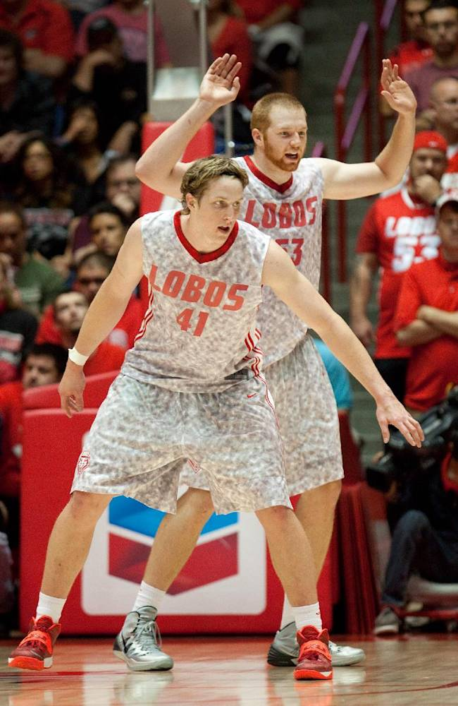 New Mexico's Cameron Bairstow, left, and Alex Kirk defend the basket against Alabama A&M in the second half of an NCAA basketball game in Albuquerque, N.M., Saturday, Nov. 9, 2013. New Mexico won 88-52