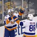 New York Islanders center Frans Nielsen (51) celebrates his goal with teammate Nikolai Kulemin (86) during the first period of an NHL hockey game against the Boston Bruins in Boston, Thursday Oct. 23, 2014. (AP Photo/Charles Krupa)