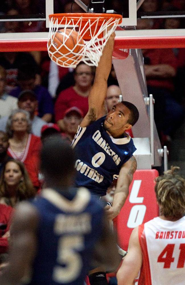 Charleston Southern's Arlon Harper dunks the ball against New Mexico in the first half of an NCAA basketball game, Sunday, Nov. 17, 2013 in Albuquerque, N.M. New Mexico won 109-93