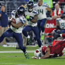 Seattle Seahawks running back Marshawn Lynch (24) breaks free from Arizona Cardinals outside linebacker Alex Okafor (57) for a touchdown run during the second half of an NFL football game, Sunday, Dec. 21, 2014, in Glendale, Ariz. (AP Photo/Rick Scuteri)