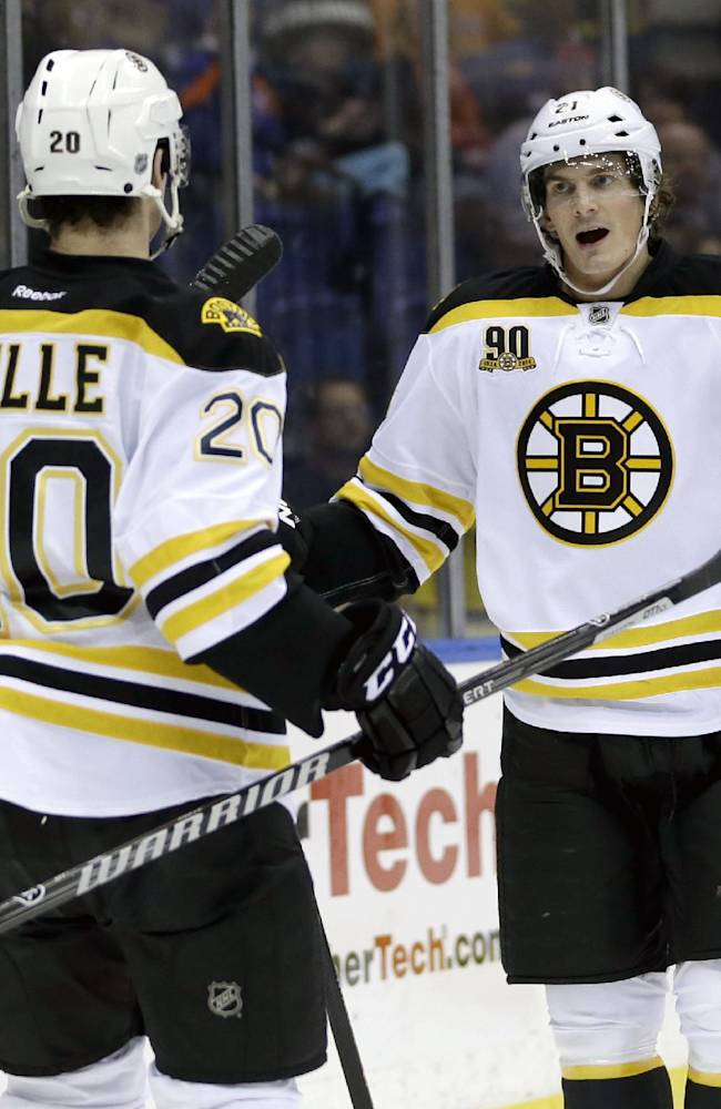 Boston Bruins' Loui Eriksson, right, celebrates his goal with teammate Daniel Paille during the first period of the NHL hockey game against the New York Islanders, Monday, Jan. 27, 2014, in Uniondale, New York