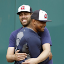 Atlanta Braves relief pitcher Jordan Walden, back, greets relief pitcher Juan Jaime during a spring training baseball workout, Thursday, Feb. 13, 2014, in Kissimmee, Fla The Associated Press