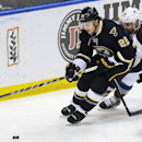 St. Louis Blues' Kevin Shattenkirk (22) gets the puck past Colorado Avalanche's Marc-Andre Cliche (24) during the second period of an NHL hockey game, Saturday, April 5, 2014, in St. Louis The Associated Press