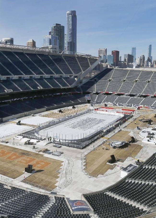 Work continues to transform Soldier Field for Saturday's Stadium Series NHL hockey game between the Chicago Blackhawks and the Pittsburgh Penguins, Thursday, Feb. 27, 2014, in Chicago