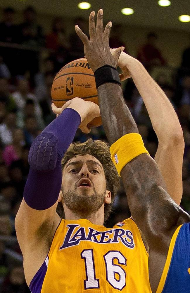 Pau Gasol of the LA Lakers shoots over Jermaine O'Neal of the Golden State Warriors,  during their NBA Global Game at the Wukesong Stadium in Beijing Tuesday, Oct. 15, 2013. The Warriors defeated Lakers 100-95
