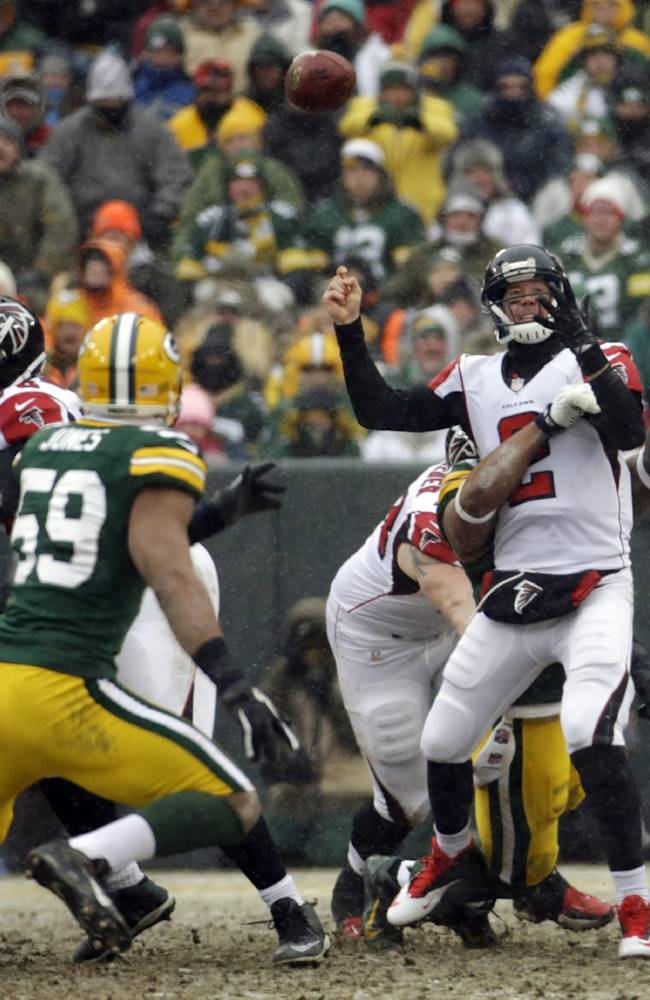 Atlanta Falcons' Matt Ryan fumbles as he is hit during the second half of an NFL football game against the Green Bay Packers Sunday, Dec. 8, 2013, in Green Bay, Wis. The Packers recovered the fumble