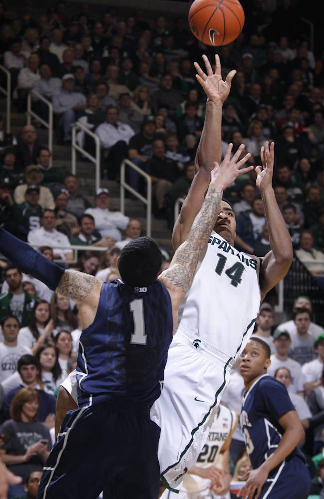 Michigan State's Gary Harris (14) shoots against Penn State's John Johnson (1) during the second half of an NCAA college basketball game, Thursday, Feb. 6, 2014, in East Lansing, Mich. Michigan State won 82-67