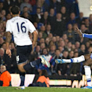 Chelsea's Demba Ba, right, shoots to score past Tottenham Hotspur's Hugo Lloris, during their English Premier League soccer match, at the Stamford Bridge Stadium in London, Sunday, March 8, 2014