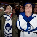 Toronto Maple Leafs fans react to the Boston Bruins' overtime game winning goal in game 7 first round NHL action while watchi
