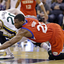 Utah Jazz's Gordon Hayward (20) and Philadelphia 76ers' Thaddeus Young (21) dive for a loose ball in the second quarter of an NBA basketball game on Wednesday, Feb. 12, 2014, in Salt Lake City The Associated Press