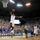 Florida forward Dorian Finney-Smith (10) goes for two points with William & Mary guard Greg Malinowski (5) unable to stop the move during the first half of NCAA College basketball in Gainesville, FL, Friday, Nov., 14, 2014. Florida defeated William & Mary 68-45.m (AP Photo/Phil Sandlin)