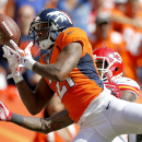 Denver Broncos cornerback Aqib Talib (21) breaks up a pass intended for Kansas City Chiefs wide receiver Dwayne Bowe during the first half of an NFL football game, Sunday, Sept. 14, 2014, in Denver The Associated Press