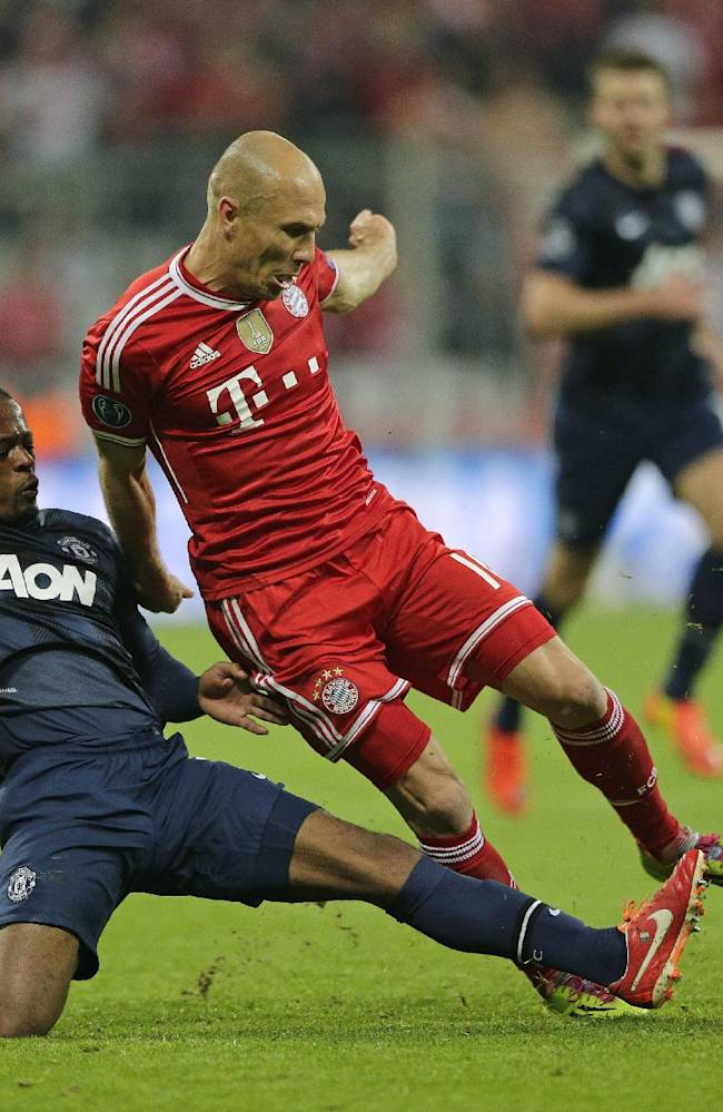 Manchester United's Patrice Evra, left, fouls Bayern's Arjen Robben during the Champions League quarterfinal second leg soccer match between Bayern Munich and Manchester United in the Allianz Arena in Munich, Germany, Wednesday, April 9, 2014