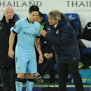 Manchester City's manager Manuel Pellegrini, right, gives instructions to Samir Nasri during the English Premier League soccer match between Leicester City and Manchester City at King Power Stadium, in Leicester, England, Saturday, Dec. 13, 2014